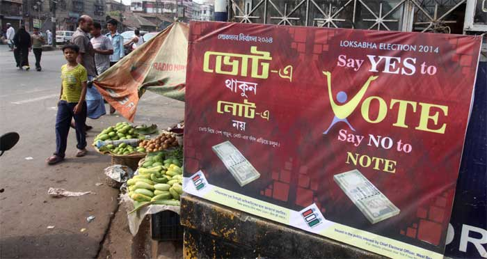 A hoarding 'say yes to vote, say no to note', issued in the public interest by the Chief Electoral officer, West Bengal is displayed at a North Kolkata area. (Express Photo: Partha Paul)