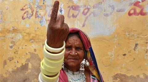 A tribal woman displays the indelible ink mark on her finger after casting her vote  on the outskirts of Hyderabad on Wednesday. (AP)