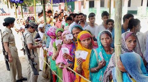 oters standing in a lqueue to cast their votes in Araria on Thursday. (PTI)