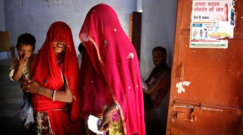 Women wait to cast their votes during the sixth phase of polling of the Indian parliamentary elections at a village near Sawai Madhopur, Rajasthan on Thursday. (AP)