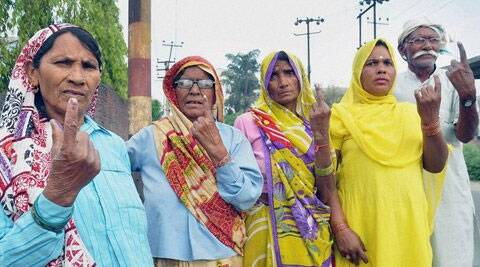 Voters show their ink marked fingers after casting votes for Lok Sabha elections in Moradabad, Uttar Pradesh on Thursday. (PTI)