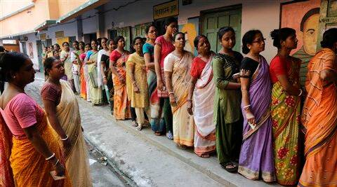 Women stand in a queue to cast their votes at a polling booth in Howrah district on Wednesday. (AP)
