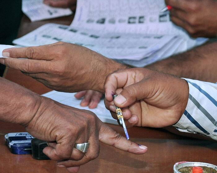 A voter gets his finger inked while casting his vote for Lok Sabha elections in Bikaner on Thursday. (PTI)