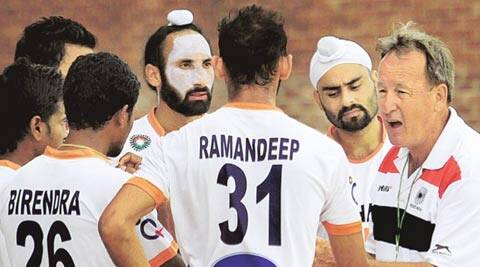 India skipper Sardar Singh with teammates pay attention to Terry Walsh (R) during a training session at the Major Dhyan Chand Stadium (IE Photo Ravi Kanojia)