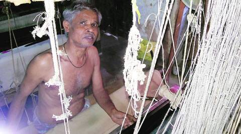 Mohammed Basheer at the handloom. (IE Photo)