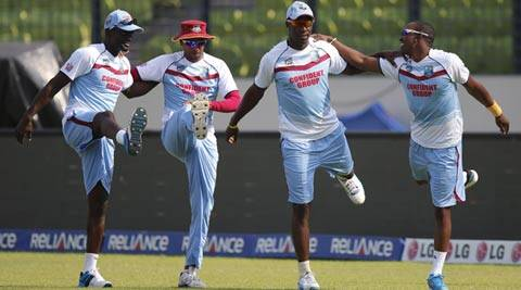 West Indies' players, from left, Andre Fletcher, Samuel Badree, Andre Russell and Dwayne Bravo perform stretching exercises during a training session (AP)