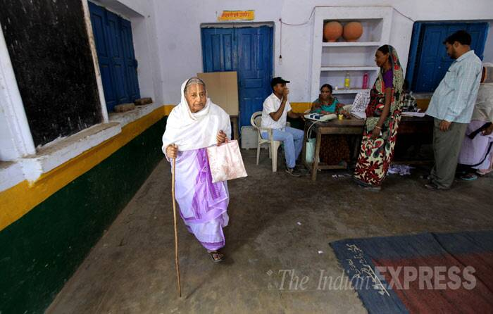 Once abandoned, a proud voter in Vrindavan leaves after casting her vote in Vrindavan on Thursady. (IE Photo: Ravi Kanojia)