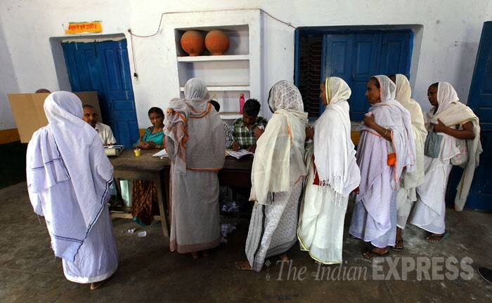 Widows at a polling station in Vrindavan. (IE Photo: Ravi Kanojia)