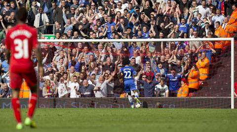 Chelsea's Willian scores his team's second goal during their English Premier League match against Liverpool at Anfield on Sunday. (AP)