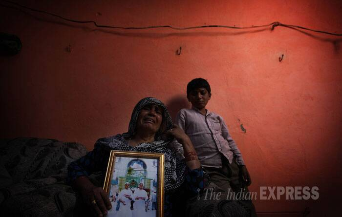 A woman shows a photograph of her two sons who were killed in the riots in Kosi Kalan near Mathura two years ago. She is seen here with her third son. (IE Photo: Tashi Tobgyal)