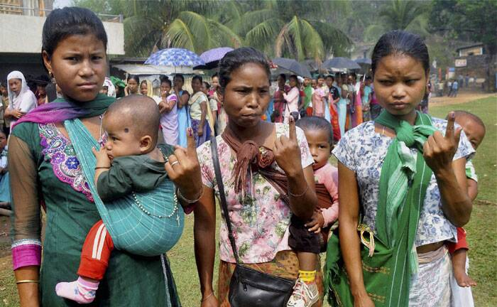 Voters shows their mark after casting their vote in a polling station for the Lok Sabha Election at a polling station at Harlibagan area, in Meghalaya on Wednesday. (PTI)