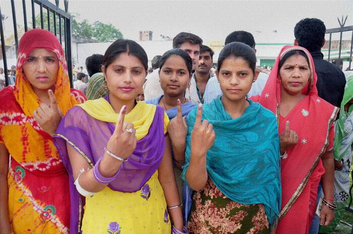 Women voters show their inked fingers after casting votes for Lok Sabha polls in Moradabad on Thursday. (PTI)