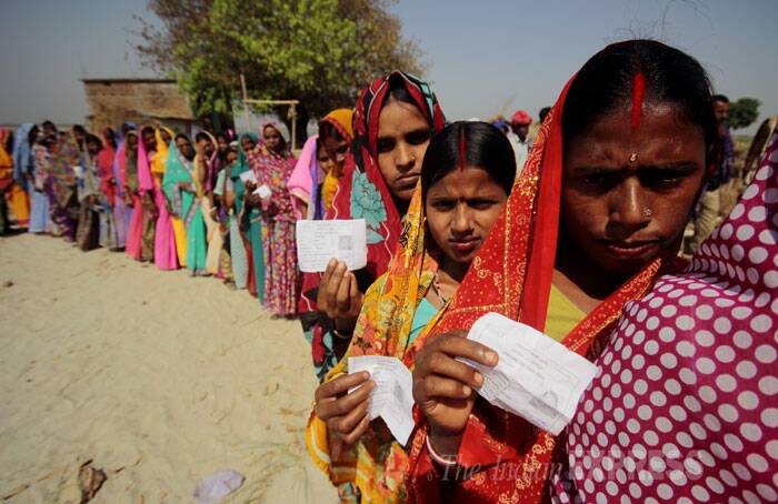 women: Women stand in a queue to cast their vote in Pataliputra constituency in Bihar on Thursday. (IE Photo: Ravi S Sahani)