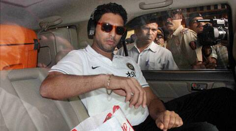 Yuvraj Singh exits Mumbai's airport on Tuesday. (PTI)
