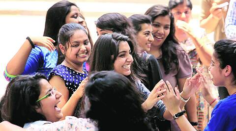 Students of St Thomas' School congratulate each other after the Class XII results were announced on Thursday. Ravi Kanojia