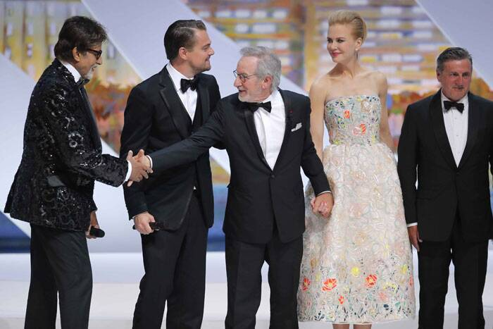 Amitabh Bachchan greeted by director and jury president Steven Spielberg. Also seen here Leonardo DiCaprio, actress Nicole Kidman and actor Daniel Auteuil on stage as the jury is presented during the opening ceremony ahead of the screening of The Great Gatsby. (AP)