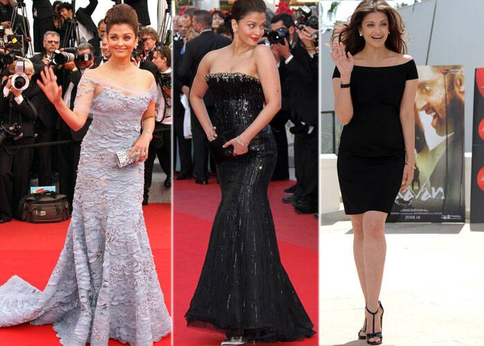 <b>Cannes 2010:</b> By this time Elie Saab had become Aishwarya's favourite designer and she was again seen in a violet mermaid gown with a train and sheer shoulders.<br />It was the year when she was promoting Raavan at Cannes and for the photo call in the afternoon it was an off shoulder black dress and open hair.<br />Then came another hit from Aishwarya - a black strapless Armani Prive gown. She added a dash of colour with her red lipstick.