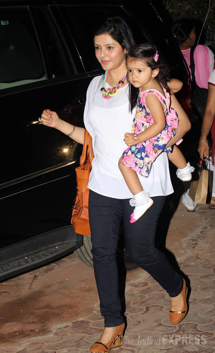 One of Viaan's little guests arrives looking cute in a pink dress with matching socks and shoes along with her mother. (Source: Varinder Chwala)