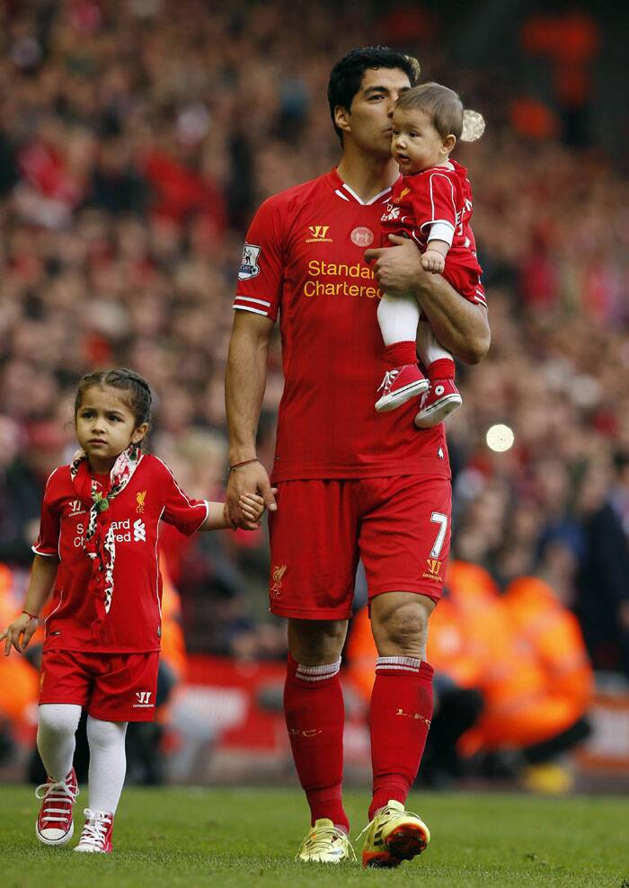 Liverpool's Luis Suarez was seen taking a walk at Anfield with his children Benjamin (R) and Delfina (L) after winning their match against Newcastle United. (Reuters)