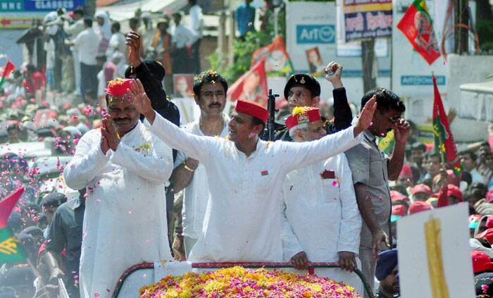 UP Chief Minister Akhilesh Yadav with his supporters during an election campaign road show in Varanasi on Saturday. (PTI)