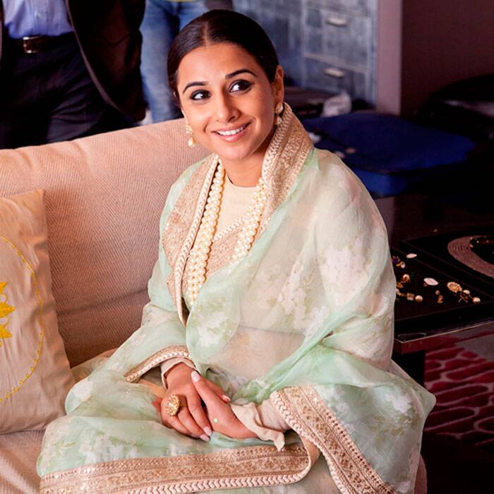 We weren't surprised to see Vidya in her regular Sabyasachi - saris and lehengas.<br /><br /> Seen here in a sea green organza sari with white blouse and pearls. No doubt Vidya looks very graceful but the pearls and the broad border make her look much older.
