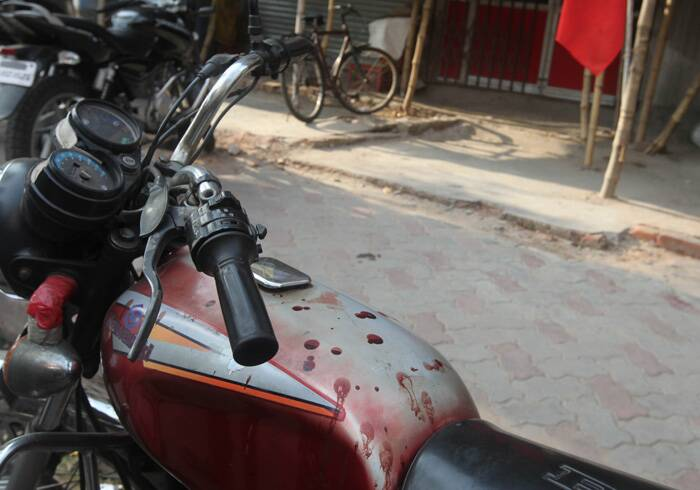 Blood stained motorbike of a CPIM supporters stands in front of party office at Beliaghata Cit road .The supporters were allegedly beaten by the TMC goons on Sunday. (Express photo: Partha Paul)