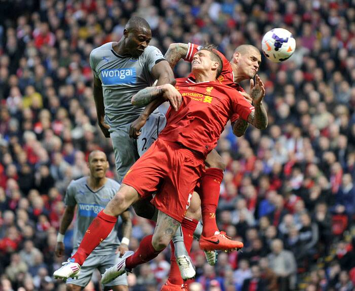 Liverpool's Daniel Agger (C) scored his team's first goal against Newcastle United in the 63rd minute of the game.  (AP)