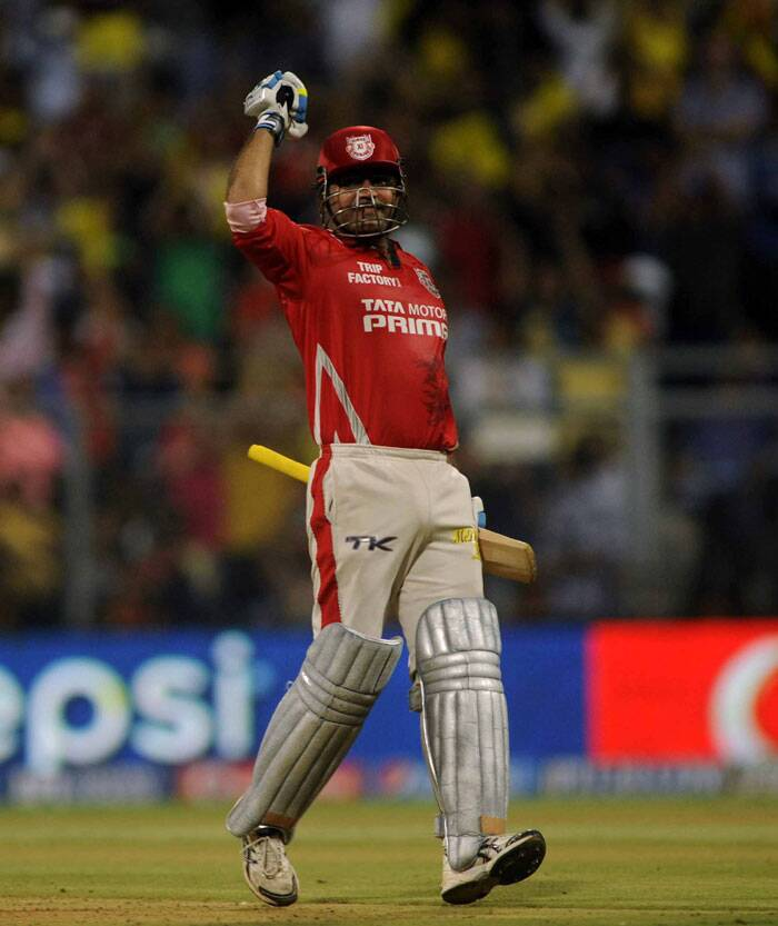 Virender Sehwag showed many emotions after the century as he raised his bat to the dressing room and had both his arms out-stretched. Sehwag was in full swing on Friday. (Source: IE Photo by Kevin D'Souza)