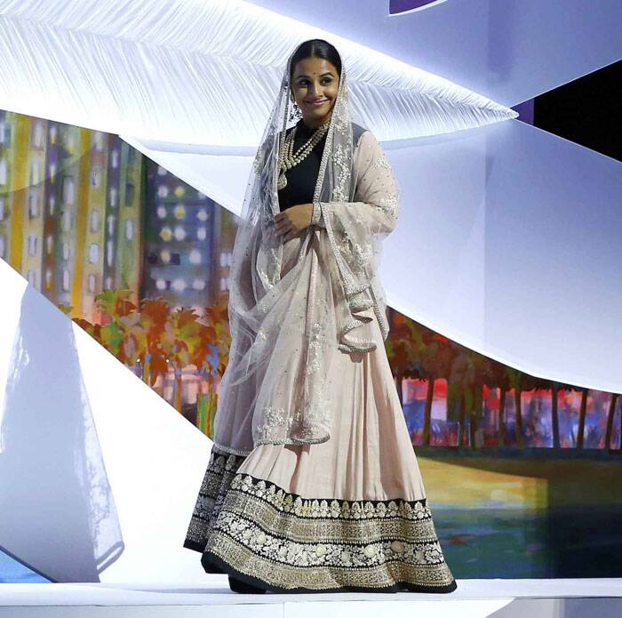 <b>At The Great Gatsby premiere:</b> Vidya Balan opted for a white lehenga and black embellished blouse where she dramatised her look by covering her head with the dupatta. But, she anyways gets a thumbs up. (Reuters)