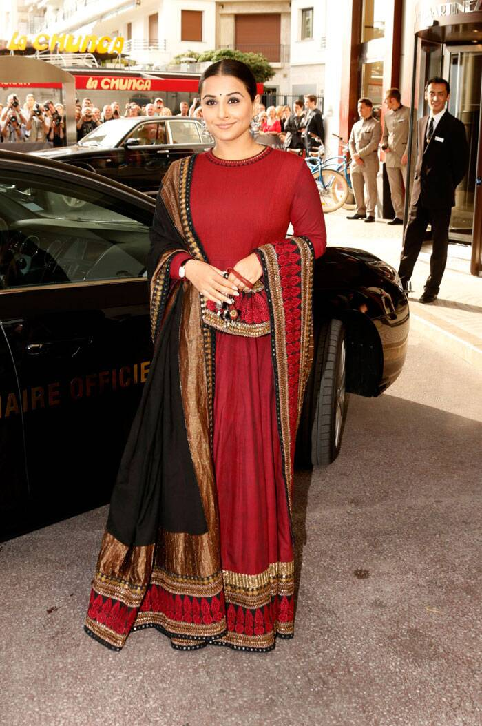 Vidya Balan looked elegant in her maroon lehenga and full-sleeved choli and completed her ethnic look with a black bindi, neatly tied bun and jhumkas. (AP)
