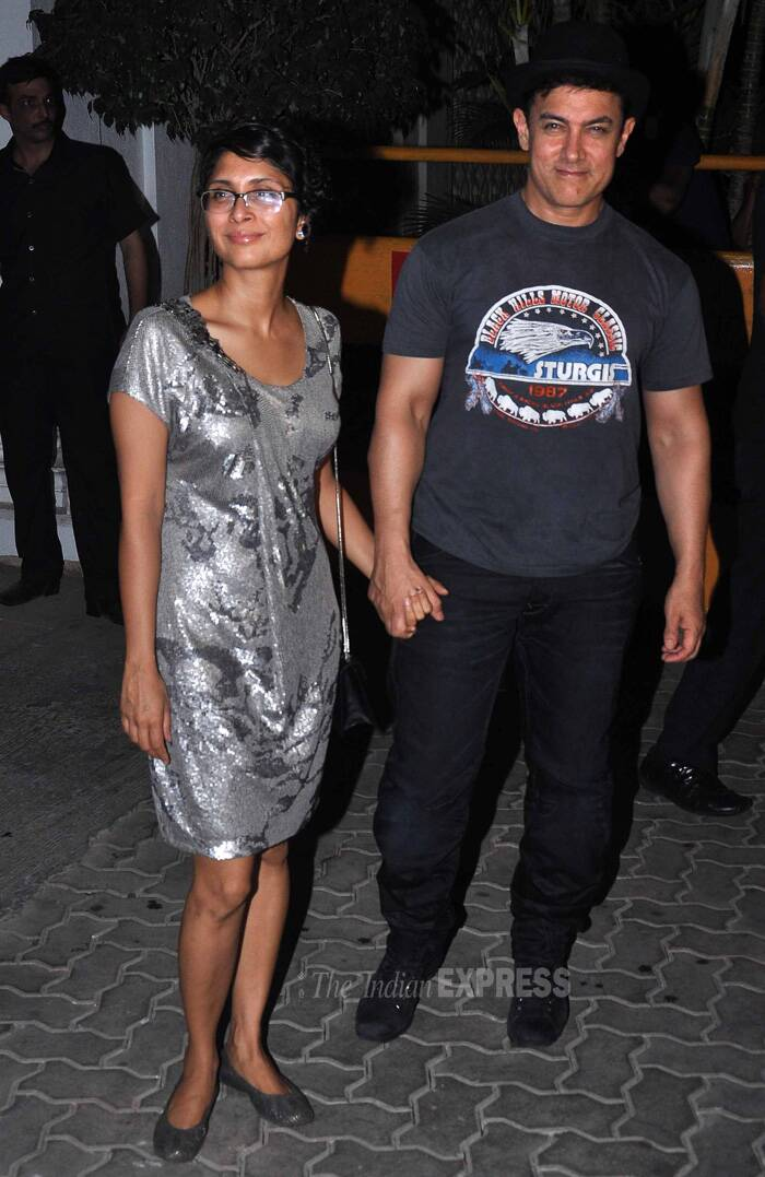 While Aamir Khan was dressed in his usual t-shirt and denims with his 'Dhoom' hat, his wife Kiran opted for a silver sequin short dress that she teamed with matching ballerinas. (Source: Varinder Chawla)