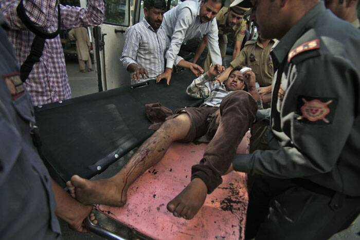 Accident occurred near Ramban, a town nearly 200 kilometers (125 miles) south of Srinagar, Kumar said. A passenger who was injured after a private bus plunged off a mountain road into a deep gorge in Kashmir is brought for treatment at the government medical college hospital in Jammu. (Source: AP)