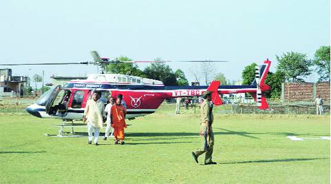 Adityanath sets out of the helicopter provided by the BJP.express