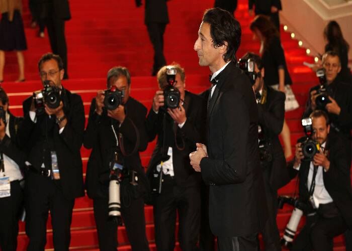 Hollywood actor Adrien Brody makes his way onto the red carpet as he arrived to attend the premiere of 'Coming Home'. (Source: AP)