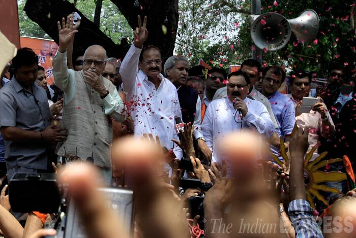 The BJP patriarch, who has not shared the best of relations with Narendra Modi in the past, called up the party's Prime Ministerial candidate as soon as it became clear that the party was headed for a clear majority of its own in the Lok Sabha polls. Seen here celebrating the win with Venkaiah Naidu at BJP headquarters in Delhi.  (Source: Express Photo by Ravi Kanojia)