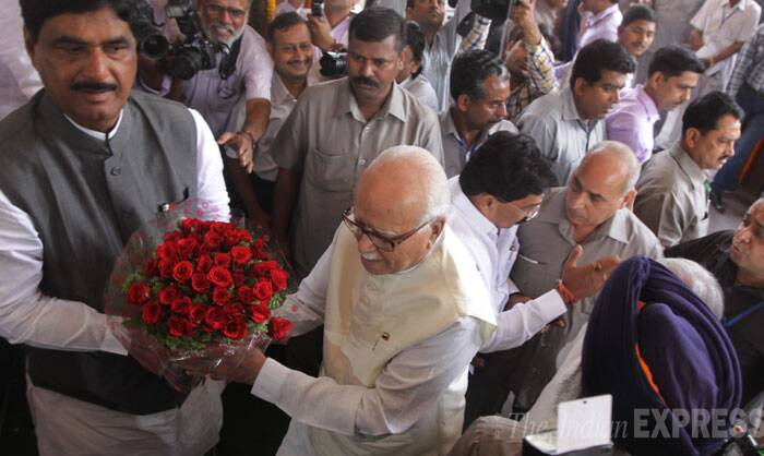 "Narendra Modi was unanimously elected as the leader of BJP Parliamentary Party with the Prime Minister-designate saying the election result was a vote for ""new hope and aspiration"" and he would try his best to live up to the expectations of the people of the country. <br /> Senior BJP leader L K Advani is welcomed outside Central Hall in New Delhi on Tuesday. (Source: Express photo by Praveen Jain)"
