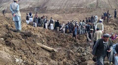 Afghans search for survivors after a massive landslide landslide buried a village. (AP Photo)