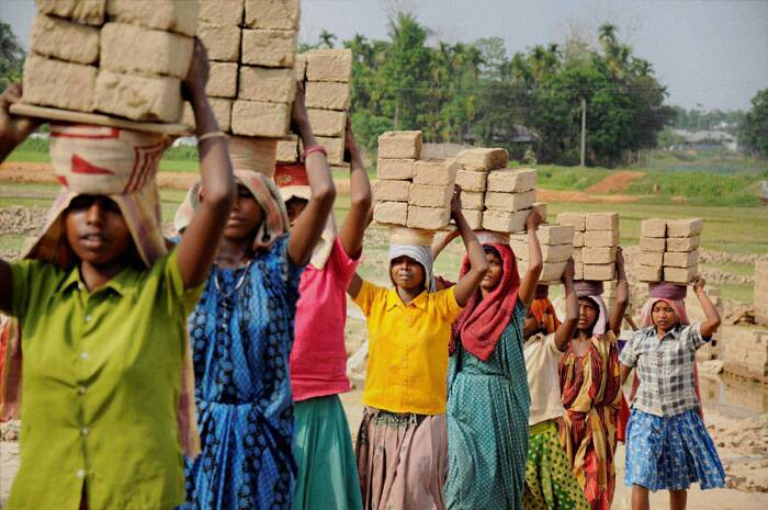 Women labourers carry bricks on their head at a brick factory on the occasion of International Labour Day in Patna. (PTI)