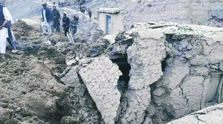 Afghan villagers gather at the site of a landslide at the Argo district in Badakhshan province Friday. (Reuters)