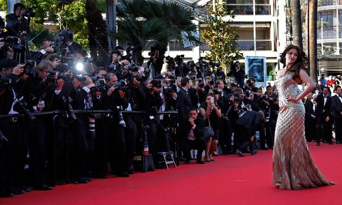 "And photogs don't want to miss any picture of the Wolrd's most beautiful woman. <br /><br /> Aishwarya Rai poses on the red carpet as she arrives for the screening of the film ""Deux jours, une nuit"" (Two Days, One Night) in competition at the 67th Cannes Film Festival. (Reuters)"