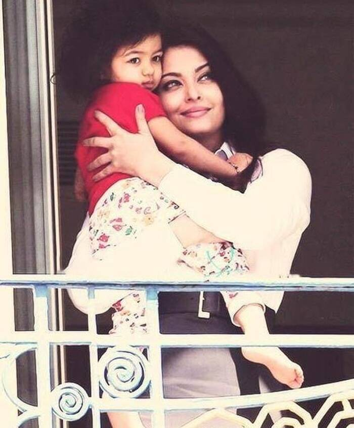 <b>Cannes 2013:</b> Last year's Cannes Film Festival was also high on anticipation by Ash fans as it marked the Cannes debut of her daughter Aaradhya Bachchan. Though, Aaradhya was nowhere with her mother on the red carpet, the images of Aishwarya holding her little bundle of joy, who had just woken up from a nap, was a hit with her fans. According to reports, Aishwarya Rai will be attending this year's festival both with her husband Abhishek Bachchan and their daughter Aaradhya. We look forward to the Ash moment at Cannes 2014!