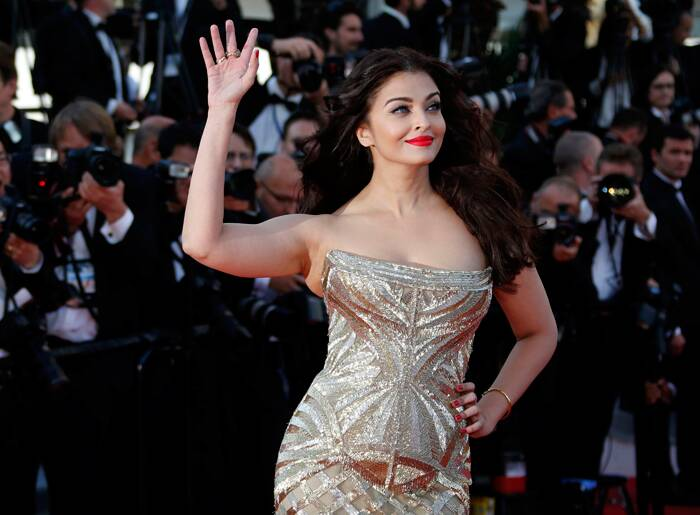 Aishwarya Rai Bachchan kept her hair open and added a pop of colour with her red lip colour.  (Reuters)