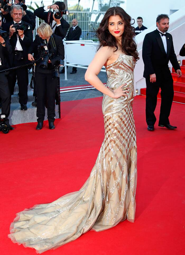 Indian beauty queen and face of L'Oreal Paris, Aishwarya Rai Bachchan was breathtaking in a gold Roberto Cavalli gown featuring a mermaid-cut pattern with a train as she arrived for the Cnnes Premiere of 'Two Days, One Night'. (Source: Reuters)