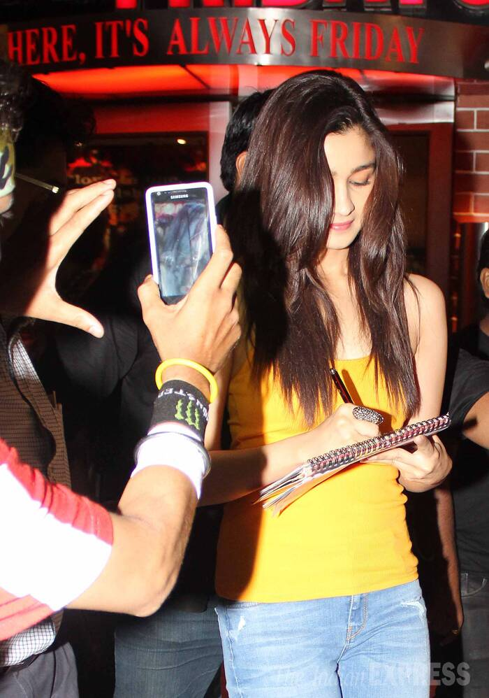 The actress, who was also exceptionally good in '2 States', signs an autograph for a fan. (Source: Varinder Chawla)