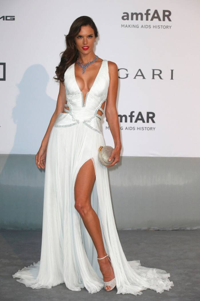 Brazilian beauty Alessandra Ambrosio hit the red carpet in a white Roberto Cavalli gown with a plunging neckline and thigh-high slit. Jimmy Choo shoes and Chopard jewellery completed her look. (Source: Reuters)
