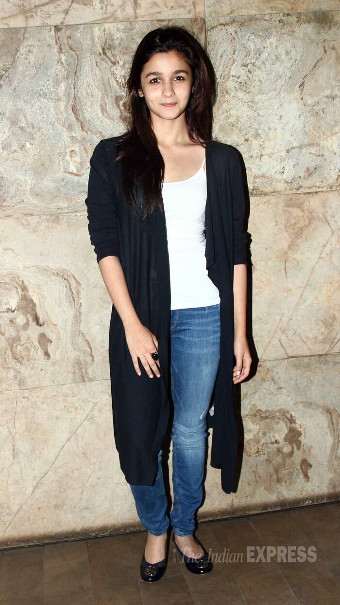 Alia Bhatt was casual for the Sunday evening outing in jeans, white top and a long jacket. (Source: Varinder Chawla)