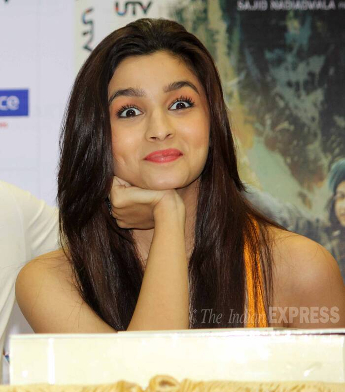 Alia makes big eyes with the cameras while flashing her dimpled smile. (Source: Varinder Chawla)