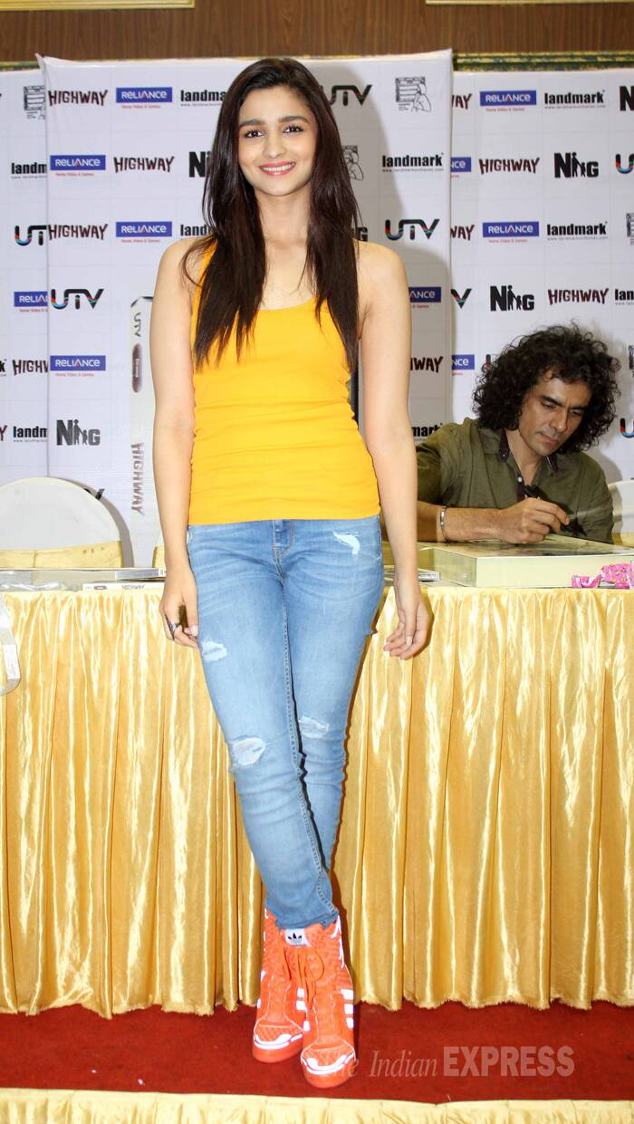 Alia Bhatt was cute in a bright yellow tank top and ripped denims with Adidas by Jeremy Scott wedge-sneakers. (Source: Varinder Chawla)