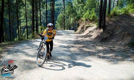 Alison Clews, 44, hiking the steep ascent on day 1. She would have to cycle another hour to reach the finish line. (Picture: HASTPA)