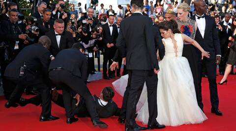 A man rushed onto the red carpet at the Cannes Film Festival and dove beneath the dress of actress America Ferrera.
